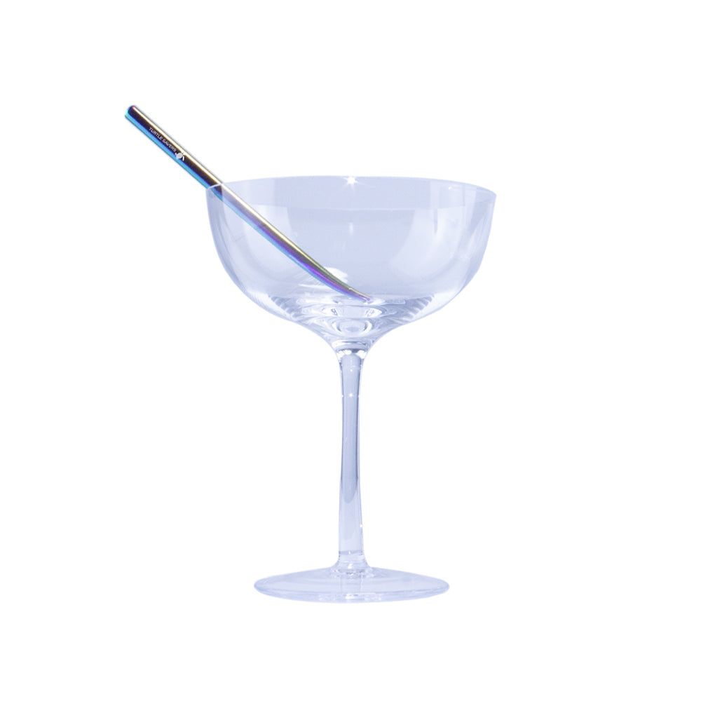 Picture of a cocktail glasses with a metal sip straw.