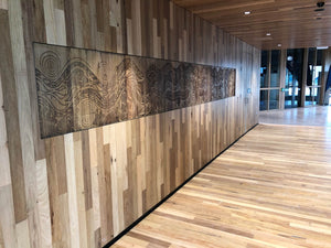 Artwork on Eucalyptus Wood built into wall at Victoria University Polytechnic