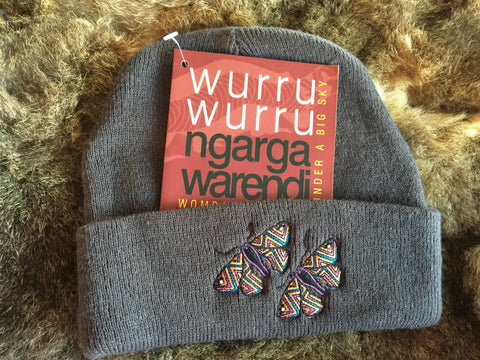 Ngarga Warendj Slate Grey Beanie with Deberer the Bogong Moth design.  Bogong Moths were gathered in the High Country  by our liwik (ancestors) during the biderap (dry season).  They are a very rich source of protein.