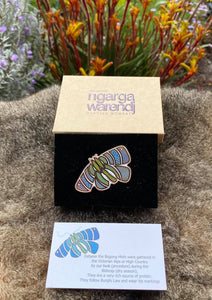 Add a finishing touch to any outfit, with this Lapel Pin featuring a Blue Bogong Moth design by Ngarga Warendj Dancing Wombat