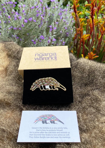 Add a finishing touch to any outfit, with this Lapel Pin featuring an Echidna design by Ngarga Warendj Dancing Wombat