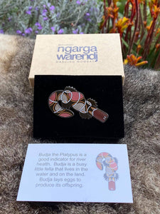 Add a finishing touch to any outfit, with this Lapel Pin featuring  Budja the Platypus design by Ngarga Warendj Dancing Wombat
