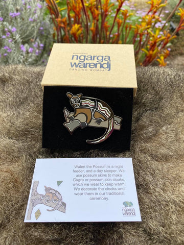 Add a finishing touch to any outfit, with this Lapel Pin featuring Walert the Possum design by Ngarga Warendj Dancing Wombat.