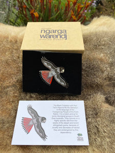 Add a finishing touch to any outfit, with this Lapel Pin featuring our Red Tailed Black Cockatoo design by Ngarga Warendj Dancing Wombat.