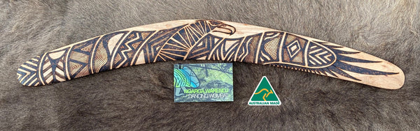 Large Bundjil the Wedge Tailed Eagle Wangim / Boomerang. Made from Stringybark timber.  Hand Crafted in Australia.  All artefacts come with an information card.  The card has information about the artist, artefact and design. All our wangim are made from timber collected from tree roots or branches that have a natural bend. All designs are based on traditional symbols from South East Australia