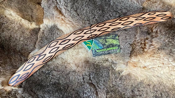 Large Barring Tracks Wangim / Boomerang. Hand Crafted in Australia by Ngarga Warendj. All our wangim are made from timber collected from tree roots or branches that have a natural bend. All designs are based on traditional symbols from South East Australia