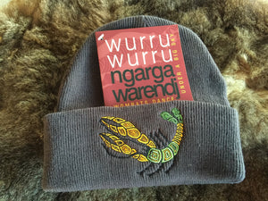 Ngarga Warendj Slate Grey Beanie with Embroidered Green & Yellow Yabby Design   Bunggan Gulum the Yabby lives in wetlands, rivers, creeks, dams   and waterways. He builds his mud brick home for protection from   the elements and from predators.  He makes very good tucker   when boiled up.