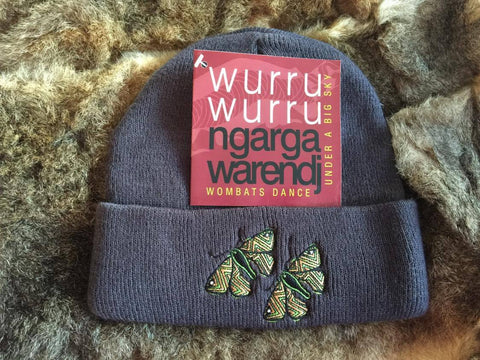 Ngarga Warendj Slate Grey Beanie with Embroidered Green Deberer the Bogong Moths Design   Deberer the Bogong Moth were gathered in the High Country  by our liwik (ancestors) during the biderap (dry season).  They are a very rich source of protein.
