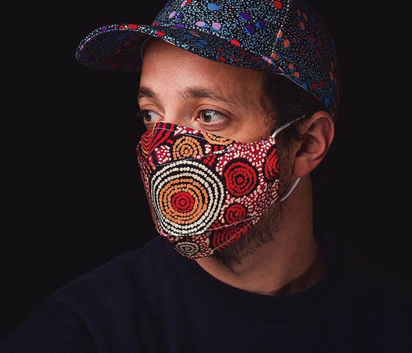 Alperstein Designs range of Australian made 100% cotton face masks featuring beautiful Aboriginal Artwork by Warlukurlangu Artists & Munupi Arts.  There's a filter pocket on the inside of the mask. using the  adjustable nose wire, you can adjust the mask for a close fit to  your face. Elastic loops fit around your ears to hold the mask in  place.  One size fits most. These masks do not claim to give you respiratory protection from viruses but may help prevent the spread of germs to others.