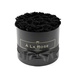 Black Roses In A Round Box