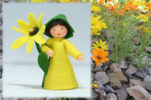 African Daisy Prince (miniature standing felt doll, holding flower) - Eco Flower Fairies LLC - Waldorf Doll Shop - Handmade by Ambrosius