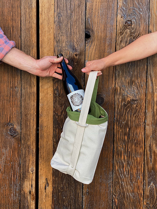 Sharing two bottles of Martha Stoumen wines in an Aplat Vin Tote