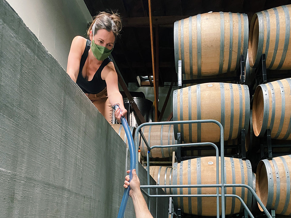 Martha Stoumen working in the winery wearing Aplat Mask