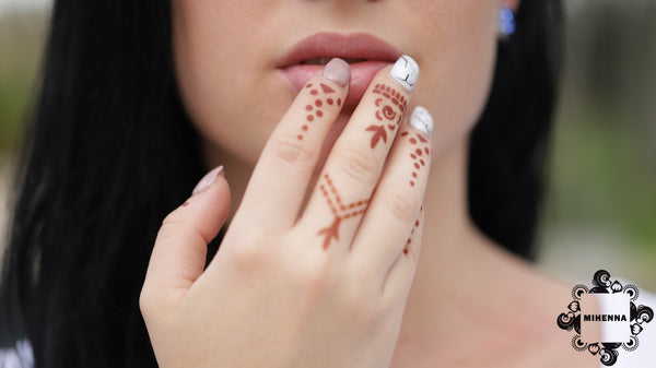 Henna jewelry - ring designs on woman's hand by Mihenna