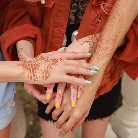 Closeup of hands with henna tattoos