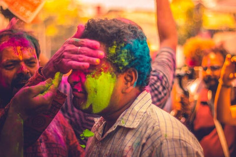 Hindus celebrate Holi with colored powders