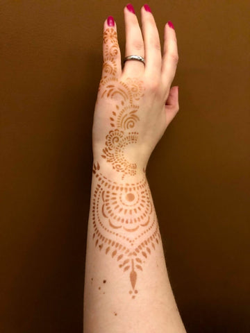 Henna tattoo design on back of hand and wrist