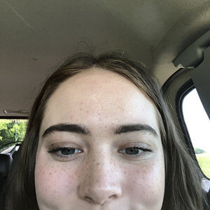 Mihenna customer wearing henna freckles on her face