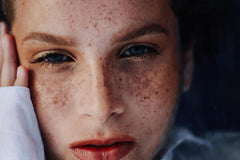 Close up of girl with henna freckles