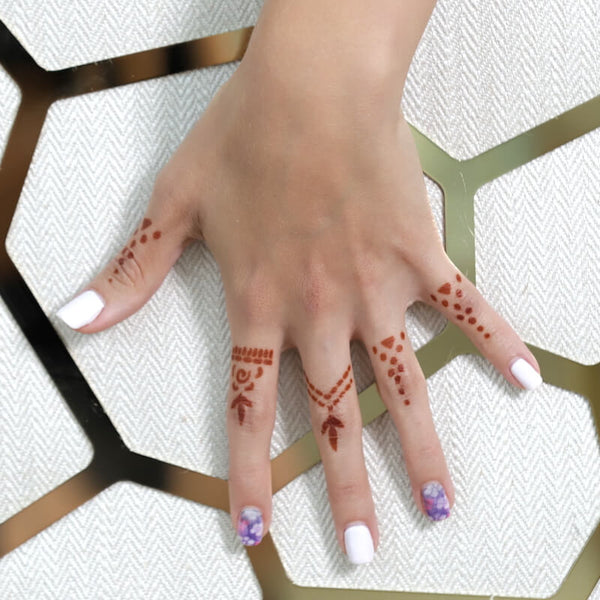 Variety of henna rings on fingers