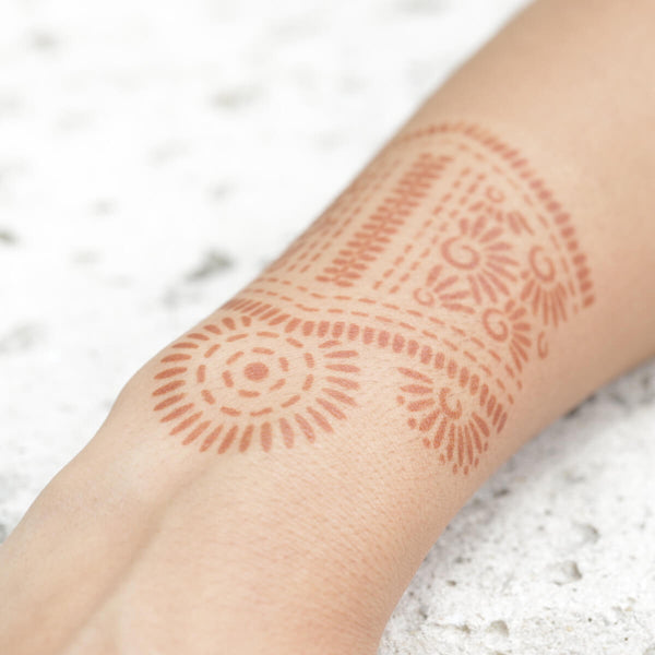 Aphrodite - close up of bangle henna design on wrist