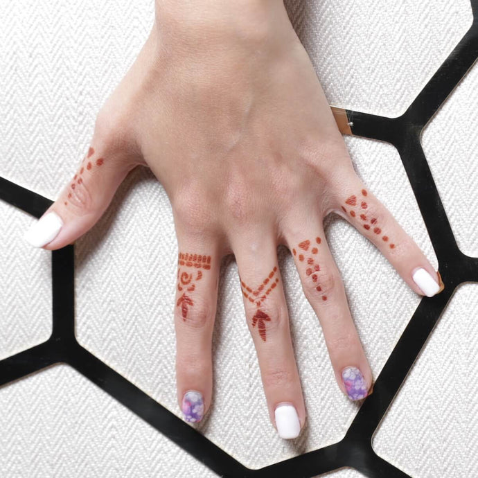Aria - close up of finger henna tattoos