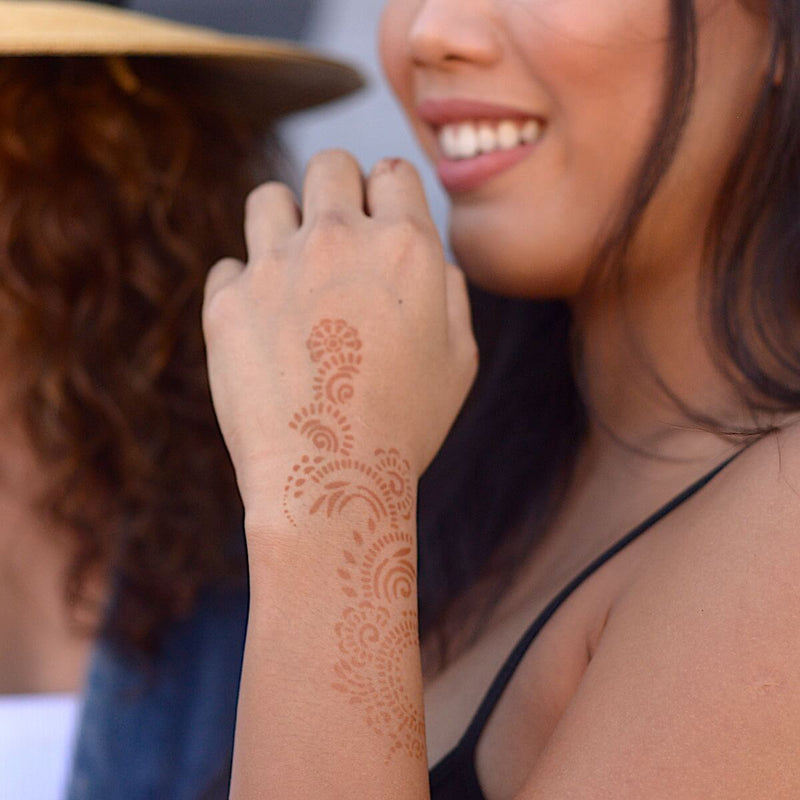 Athena - Woman with back hand henna tattoo