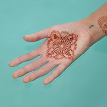 Load image into Gallery viewer, Blooms - mandala henna tattoo on palm in water