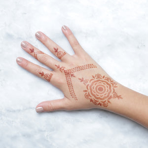 Camellia - rings and mandala henna designs on back of hand