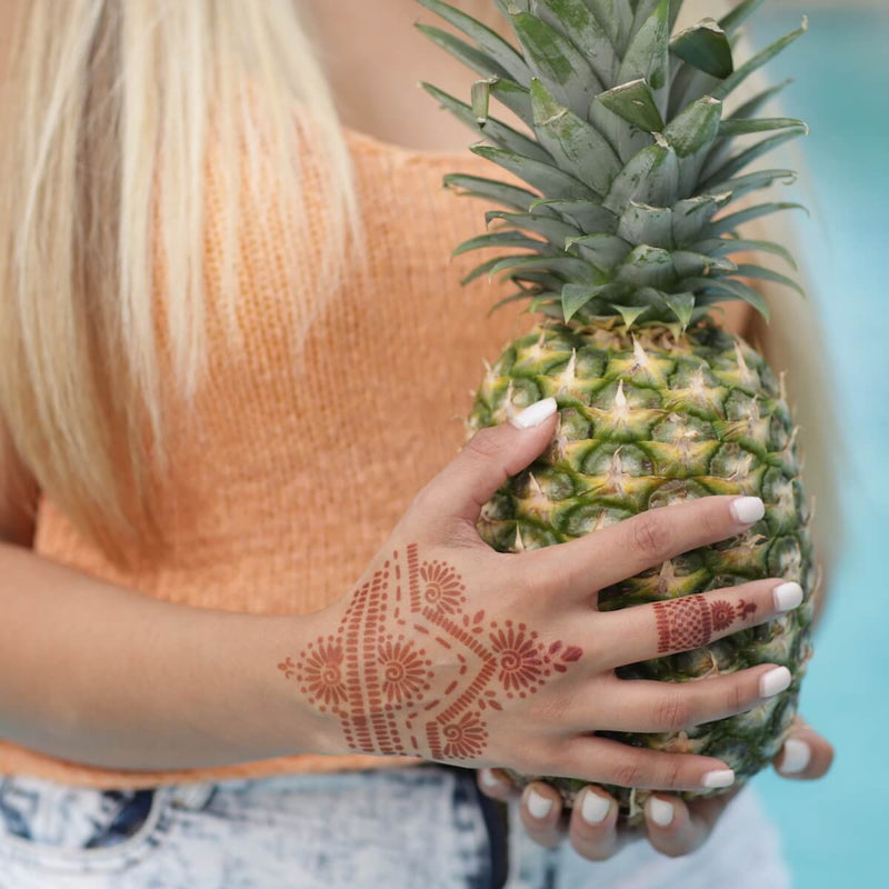 Dahlia - woman with back of hand and ring henna design