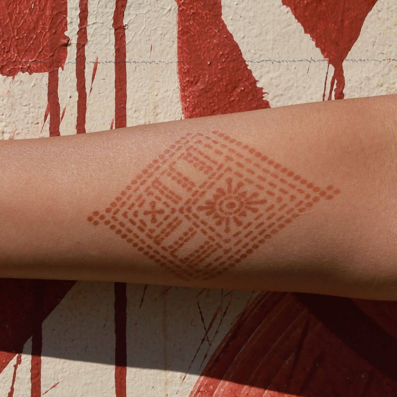 Fauzie - geometric henna tattoo on forearm
