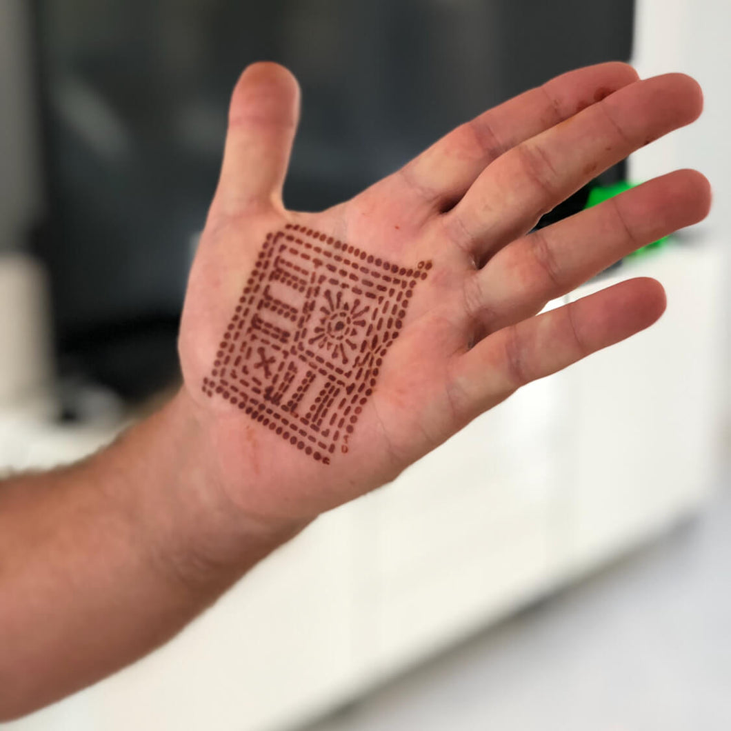Fauzie - geometric henna design on palm
