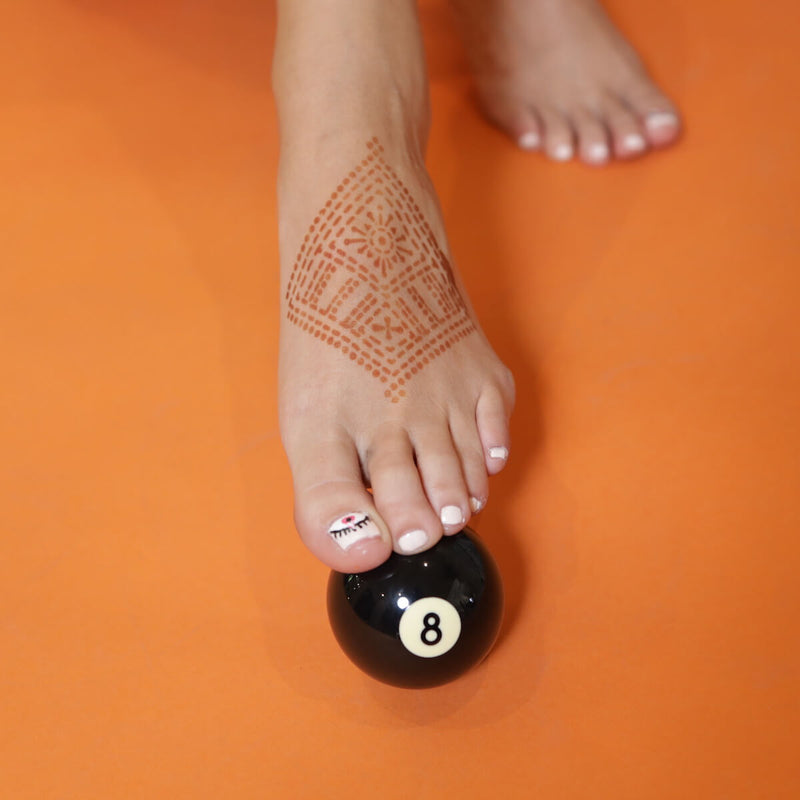 Fauzie - geometric henna design on foot