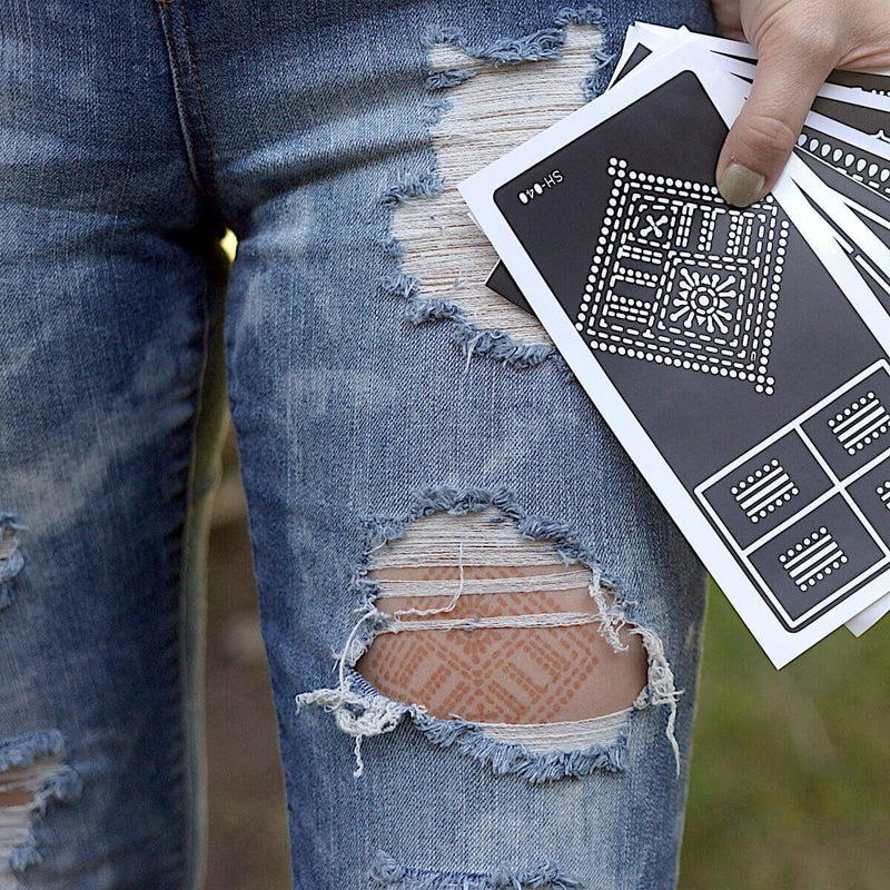 Fauzie - Woman with henna tattoo under ripped jeans and holding sticker stencils
