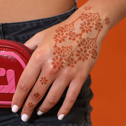 Flower Power - floral henna tattoo on back of hand