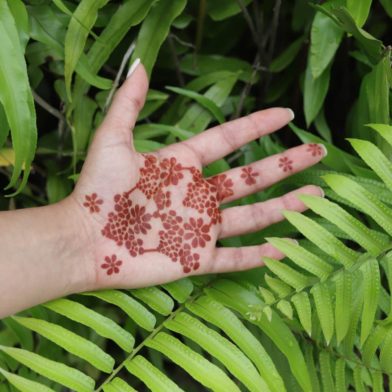 Flower Power - palm with floral henna design