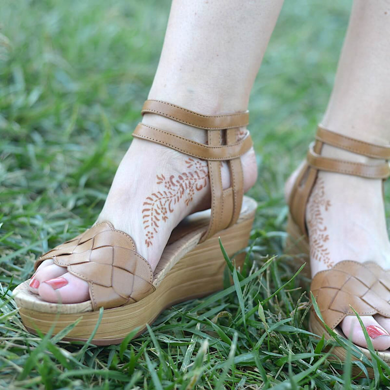 Ivy - Woman with henna tattoo on feet with sandals