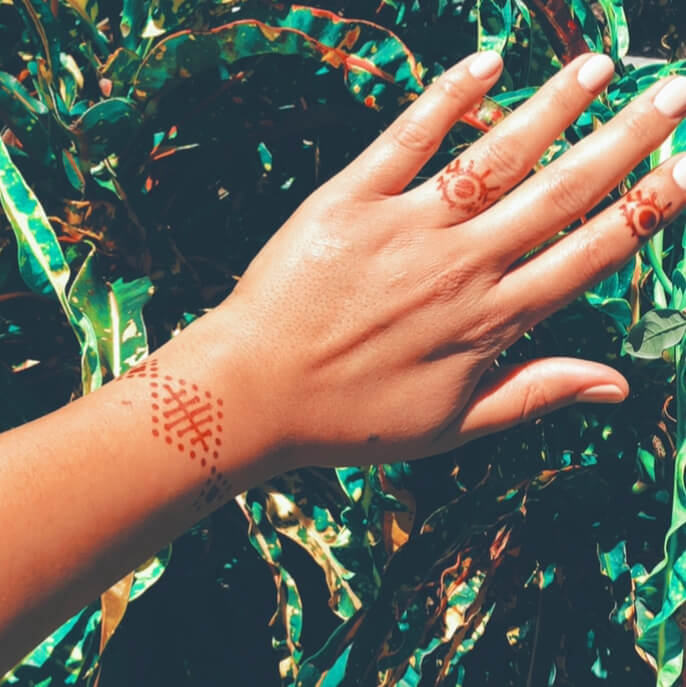 Karma - geometric henna design on wrist