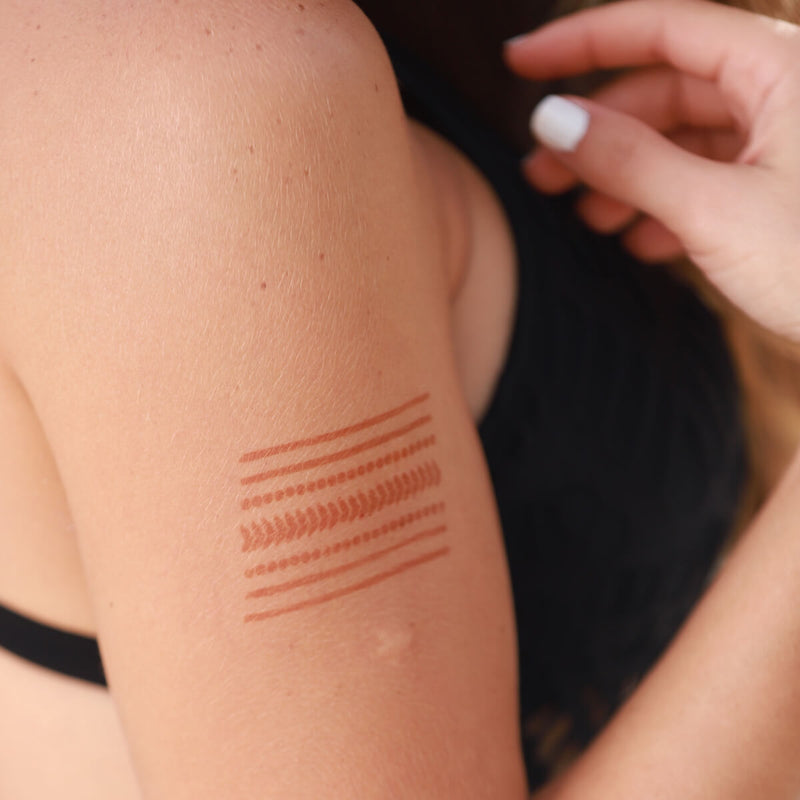 Miami - linear henna design on woman's shoulder