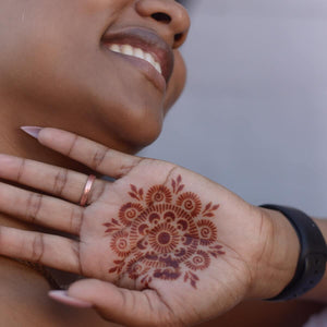 Passion Fruit - woman with mandala henna tattoo on palm