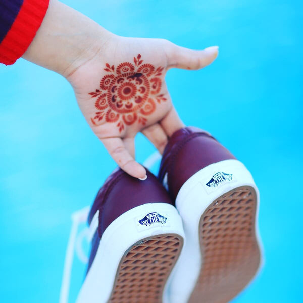 Passion Fruit - mandala henna design on palm