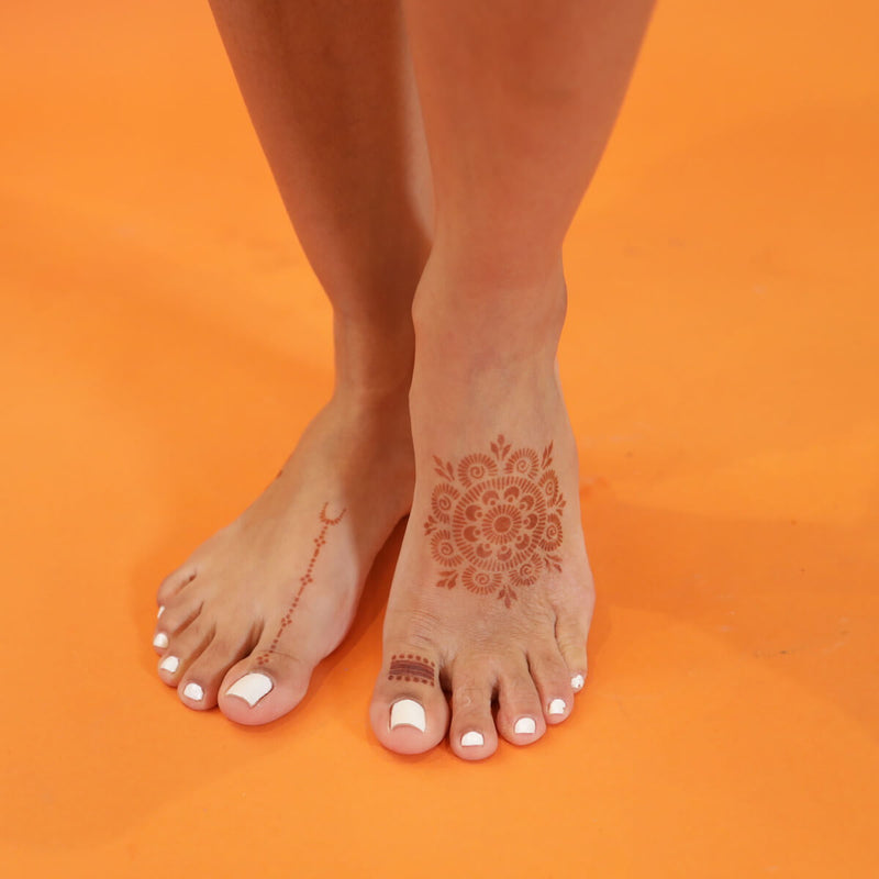 Passion Fruit - feet with mandala and rings henna design