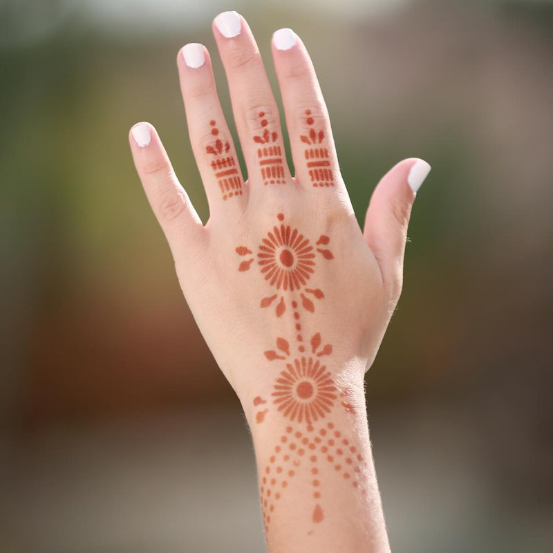 Pearl - geometric henna design on back of hand
