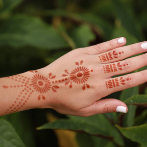 Pearl - back of hand henna design in nature setting