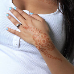 Phoenix - woman with henna tattoo on the back of her hand