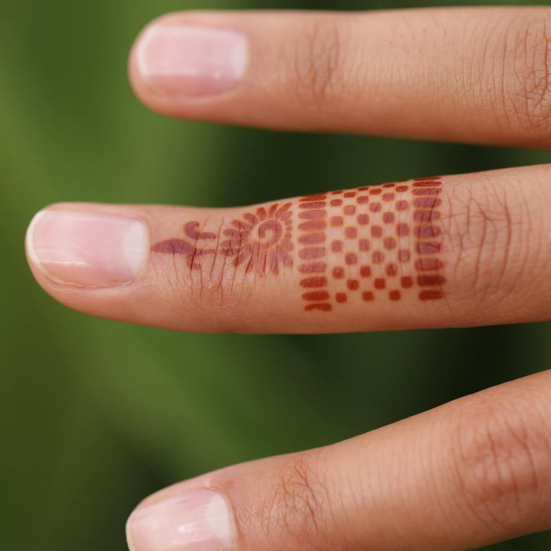 Radiant - ring henna tattoo on finger