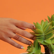 Load image into Gallery viewer, Henna ring jewelry on hand with plant