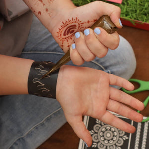 Flame Thrower - girl apply henna to a modern henna tattoo design