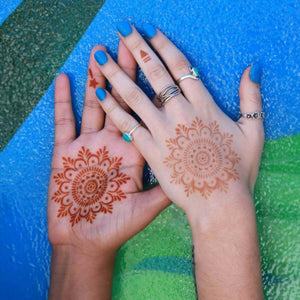 Haley - matching mandala henna designs on palms