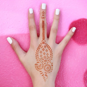 Marah - traditional paisley henna tattoo design on back of hand